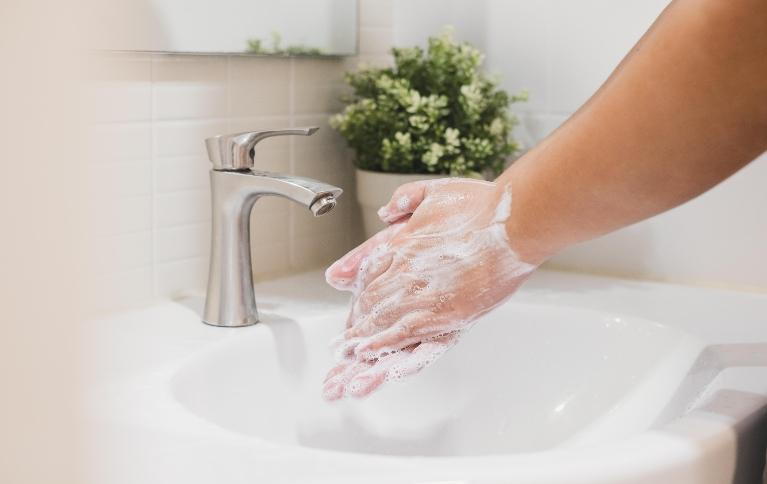 Closeup of someone washing their hands for twenty seconds to protect themselves from coronavirus